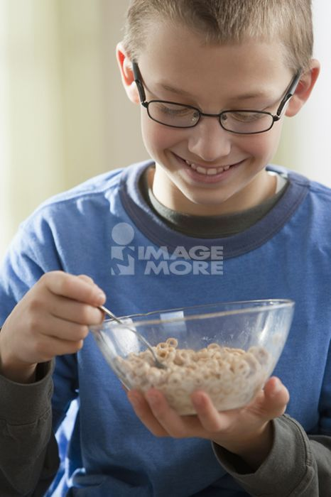 Caucasian boy eating cereal