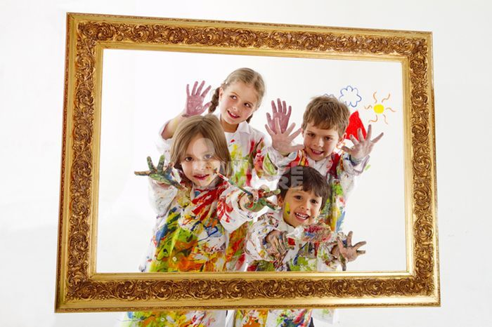 Hispanic children covered in paint inside frame