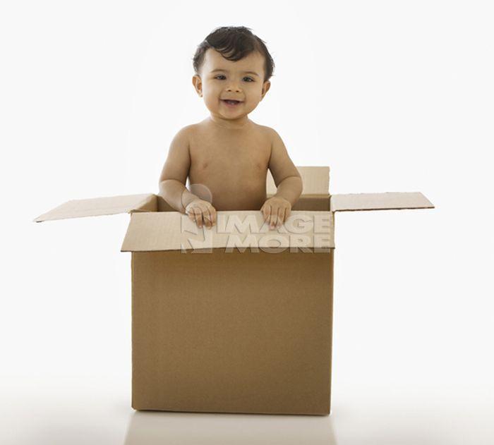 Mixed race baby boy in cardboard box