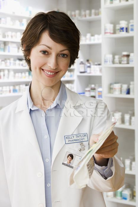 Caucasian pharmacist holding prescription
