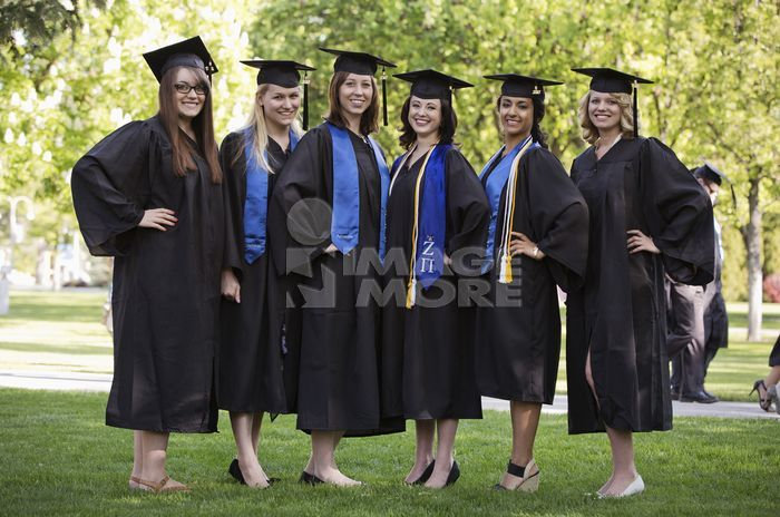 College graduates standing in a row together