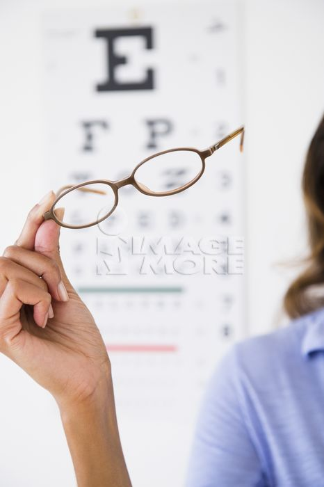 Cape Verdean woman holding eyeglasses