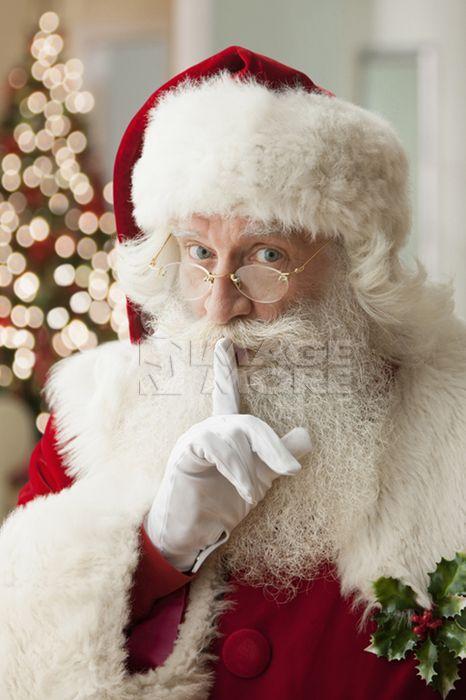 Santa making shhh gesture