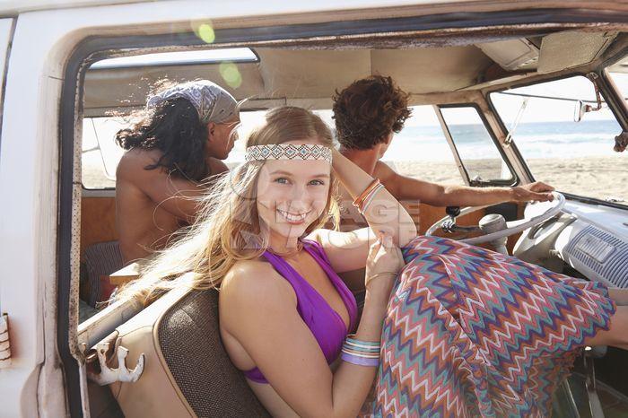 Woman smiling in van on beach