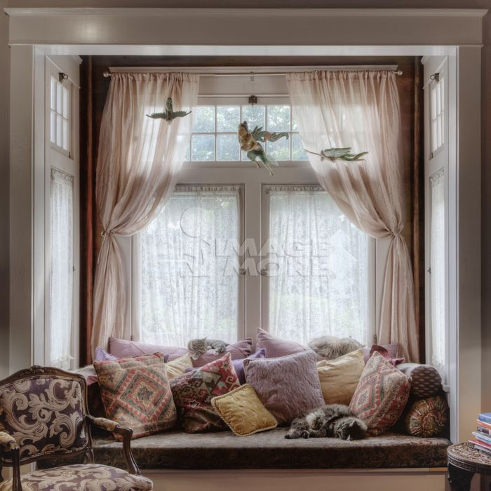 Window seat and curtains in nook