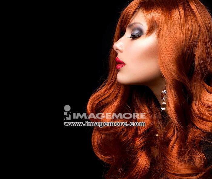 Wavy Red Hair. Fashion Girl Portrait,