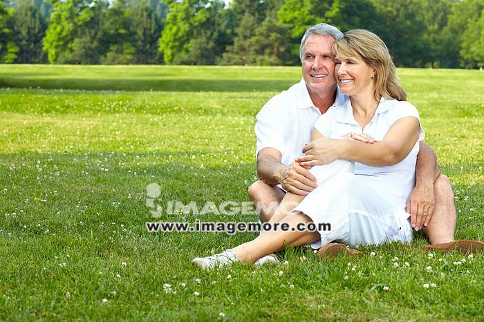 happy  elderly seniors couple in park,
