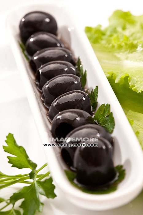 food series: macro oicture of plate with black olive,