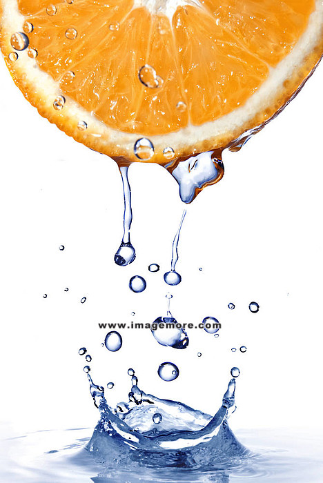 fresh water drops on orange with water splash isolated on white,