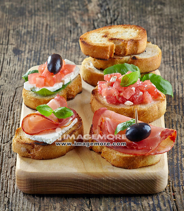 Spanish food tapas. Toasted bread with meat and vegetables,