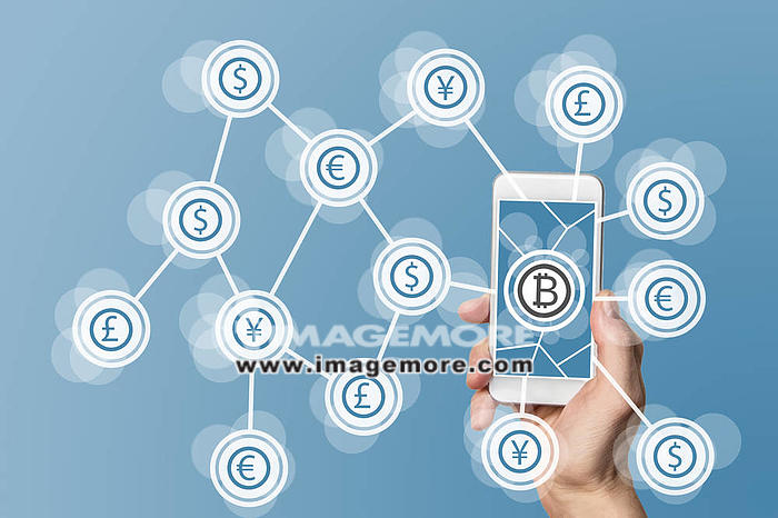 Blockchain and bitcoin technology and mobile computing concept on blue background,
