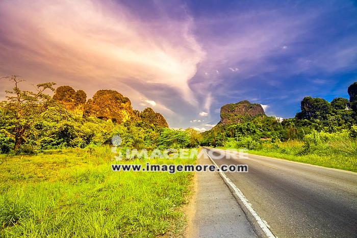 Road and mountain landscape at sunset in Thailand,