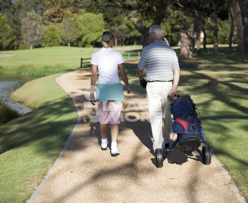 Man and woman walking on a golf course