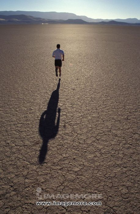A person running in a desert