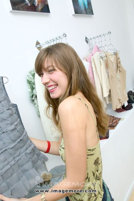Caucasian Girl Laughing While Shopping In A Trendy Boutique