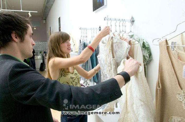 Fashionable Young Couple Shopping Together In A Boutique