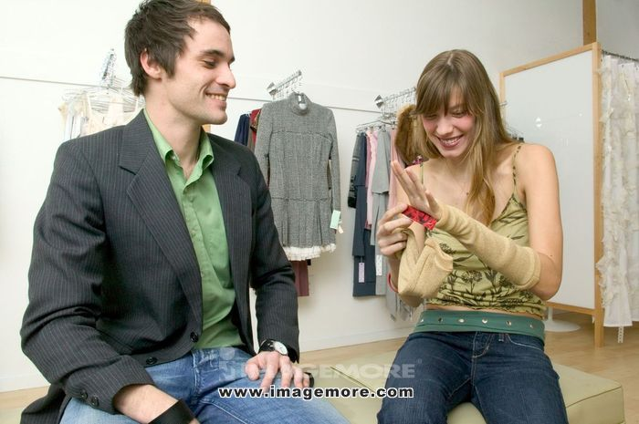 Caucasian Couple Flirting In A Fashionable Boutique