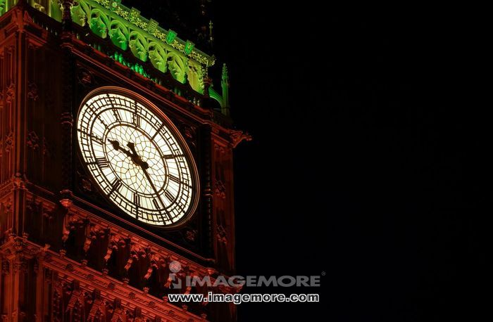 London May 2009- Illuminated clock face of Big Ben taken at night. Big Ben is part of the Houses of Parliament