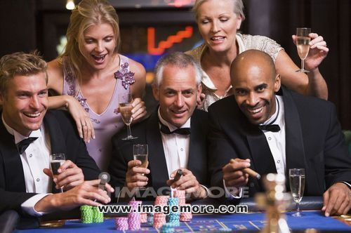 Five people in casino playing roulette and smiling (selective focus)