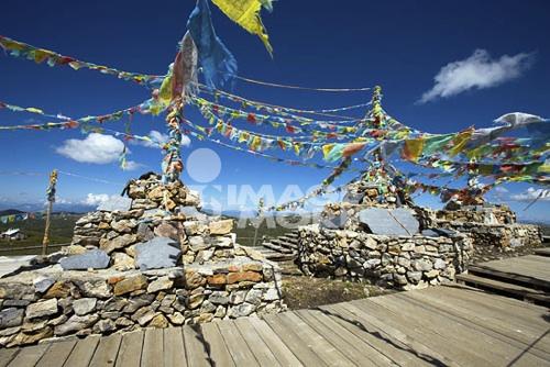 Tibetan stupas on top of Shika snow mountain, Blue Moon Valley, Shangrila, China