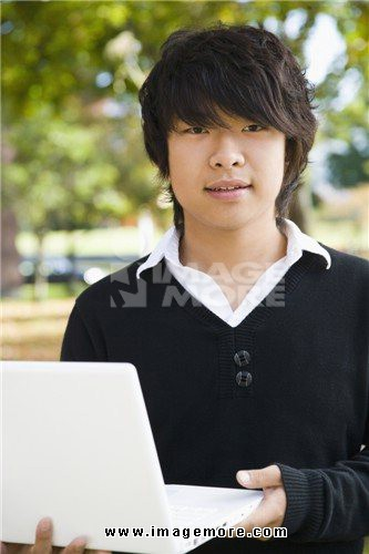 Student holding a laptop