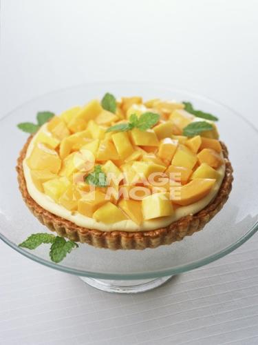 Papaya and mango tart on stand