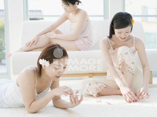 Women Filing Nails