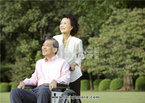 Senior couple with wheelchair