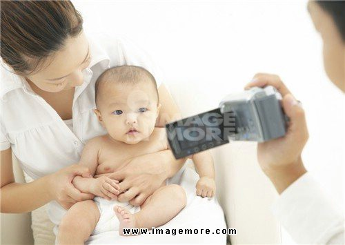 Parents and child videotaping