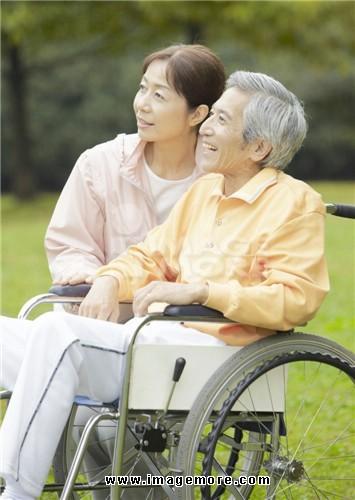 Senior couple with wheel chiar