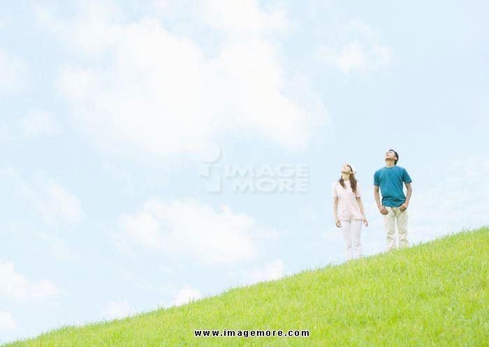 Couple standing under blue sky