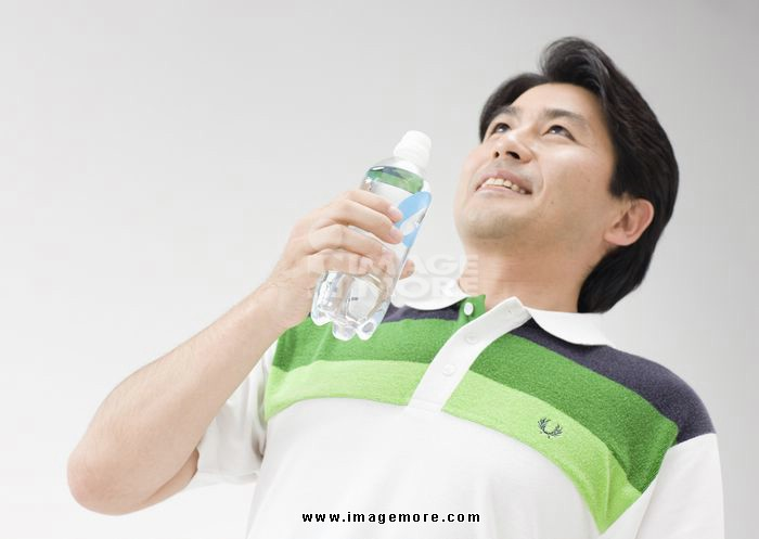 Man holding plastic bottle