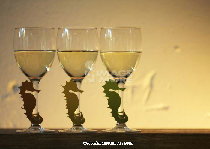 Sea horse-shaped glass markers and wineglasses