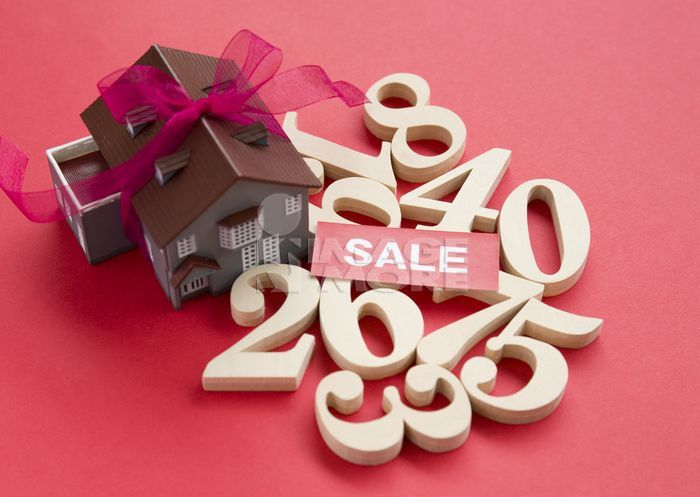 """Numbers, a word """"SALE"""" and an architectural model"""