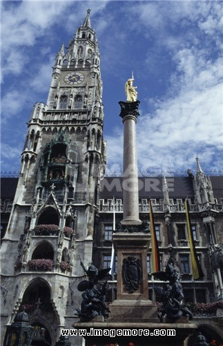 Low angle view of a column and a clock tower, Mariensaule Column, Glockenspiel, New Town Hall, Marienplatz, Munich, Germany