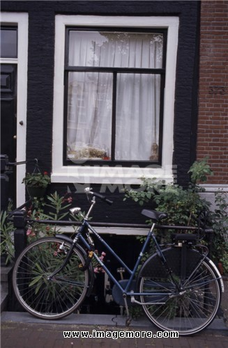 Bicycle in front of a window, Amsterdam, Netherlands
