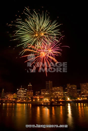 Low angle view of fireworks display in the sky at night, Cinco de Mayo Fiesta, Eastside Esplanade, Portland, Oregon, USA