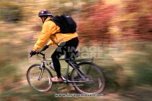 Senior woman mountain biking