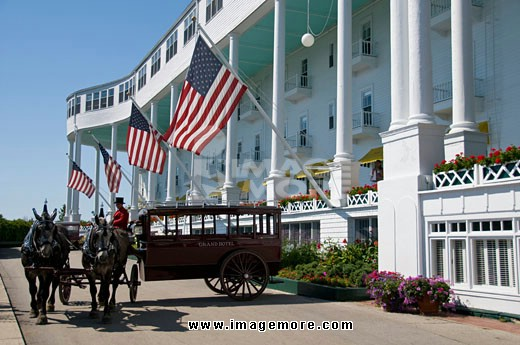 Horsedrawn carriage in front of a hotel, Grand Hotel, Mackinac Island, Michigan, USA